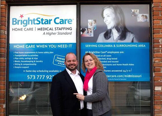 Matt and Kristine Hayes in front of their Columbia, MO BrightStar Care location